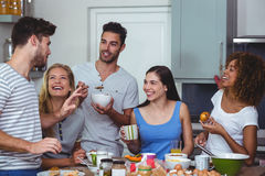 Cheerful friends discussing while having breakfast Royalty Free Stock Image