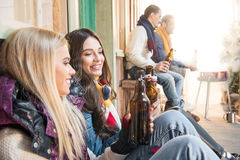 Cheerful friends drinking beer on barbecue. Side view of cheerful friends drinking beer on barbecue Stock Images