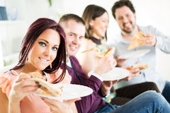 Cheerful friends eating pizza Royalty Free Stock Photography