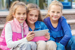 Cheerful friends with an electronic tablet Stock Photos