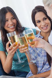 Cheerful friends enjoying white wine together Stock Photo