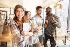 Cheerful friends expressing happiness in the cafe Stock Photos