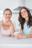 Cheerful friends having cups of coffee Royalty Free Stock Photography