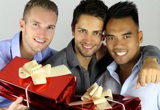 Cheerful friends holding gifts royalty free stock photo