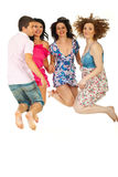 Cheerful friends jumping Royalty Free Stock Image