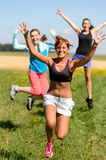 Cheerful friends jumping enjoy summer sport run Stock Image