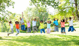 Cheerful friends jumping Royalty Free Stock Photos