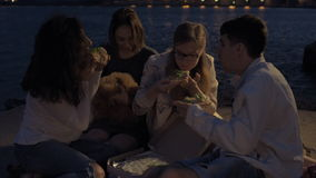 Cheerful friends at a party eating pizza. stock video footage