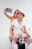 Cheerful friends are photographing themselves on motorbike Royalty Free Stock Photo