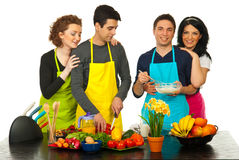 Cheerful friends preparing food Royalty Free Stock Photography