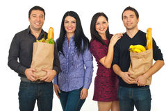 Cheerful friends shopping food Royalty Free Stock Photos