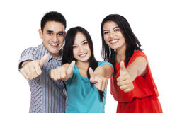 Cheerful friends showing thumbs-up 1 Stock Photo