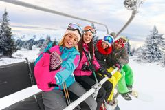 Cheerful friends skiers enjoying in the slopes at winter vacatio Royalty Free Stock Photography