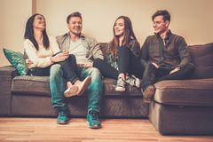 Cheerful friends on a sofa Stock Photography