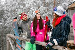 Cheerful friends spend together winter at mountain cottage Stock Image