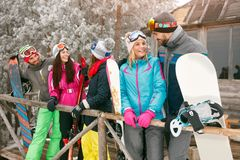 Cheerful friends spend winter at mountain cottage Royalty Free Stock Photo