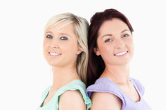 Cheerful Friends standing back to back Royalty Free Stock Images