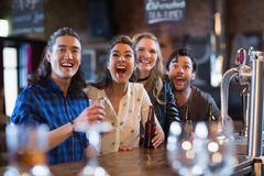 Cheerful friends standing by bar counter Royalty Free Stock Photo