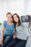 Cheerful friends taking pictures of themselves Royalty Free Stock Photo