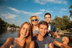 Cheerful Friends Taking Selfie On A Boat. Group Of Young Friends On A Boat Enjoying Sunny Day And Taking Selfie stock image
