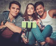 Cheerful friends taking selfie outdoors Royalty Free Stock Photography
