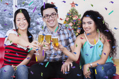 Cheerful friends toast with champagne Royalty Free Stock Photography