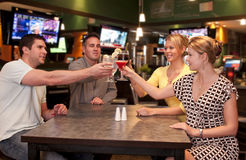 Cheerful friends toasting stock images