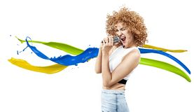 Cheerful frizzy-haired lady singing a rock song. Cheerful frizzy-haired woman singing a rock song stock photos