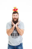 Cheerful funny man with beard put teddy bear on head Royalty Free Stock Image