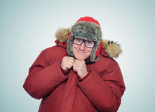 Cheerful funny man in glasses and winter clothes Stock Images