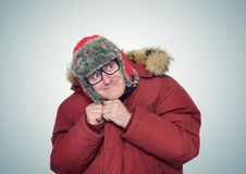 Cheerful funny man in glasses and winter clothes Royalty Free Stock Image
