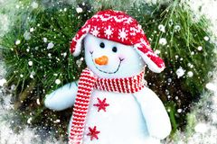 Cheerful and funny snowman in a red hat and scarf on a Christmas tree background royalty free stock images