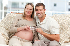 Cheerful future parents holding a sonogram Royalty Free Stock Image