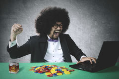 Cheerful gambler winning online poker Royalty Free Stock Photo