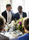 Cheerful Gay Couple in Wedding Reception stock image