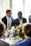 Cheerful Gay Couple in Wedding Reception royalty free stock images