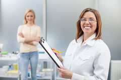 Cheerful general practitioner is ready to work Stock Photo