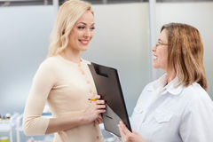 Cheerful general practitioner is working with patient Royalty Free Stock Photo