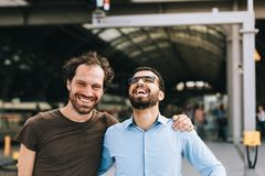 Cheerful german and syrian men laughing. Friendship between a cheerful german men and a Syrian men laughing stock images
