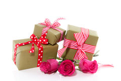 Cheerful Gifts And Pink Roses Royalty Free Stock Photo