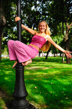 Cheerful girl. Got up on the pole Royalty Free Stock Image