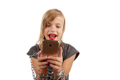 Cheerful girl addicted to smartphone shackled with chains. Isolated on white stock photo