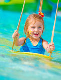 Cheerful girl in aqua-park Stock Photo