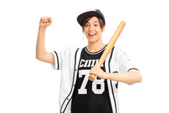 Cheerful girl in a baseball jersey holding a bat and gesturing Stock Images