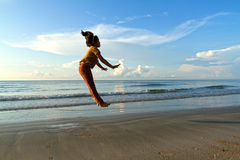 Cheerful girl on the beach at dawn Royalty Free Stock Images