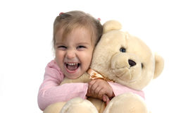 Cheerful girl with bear. Little girl holding a teddy bear Royalty Free Stock Image