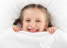 Cheerful girl in bed Royalty Free Stock Photos