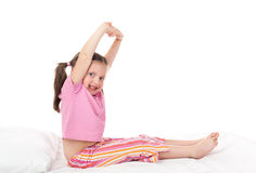 Cheerful girl in bed Royalty Free Stock Images