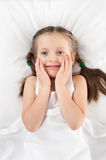 Cheerful girl in bed Royalty Free Stock Photo