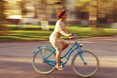 Cheerful girl on a bicycle Royalty Free Stock Image